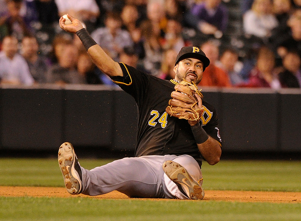 . DENVER, CO. - AUGUST 09: Pirates infielder Pedro Alvarez threw from a seated position trying to get out Rockies batter Charlie Culberson in the eighth inning. Culberson was safe. The Colorado Rockies defeated the Pittsburgh Pirates 10-1 Friday night, August 9, 2013. Photo By Karl Gehring/The Denver Post