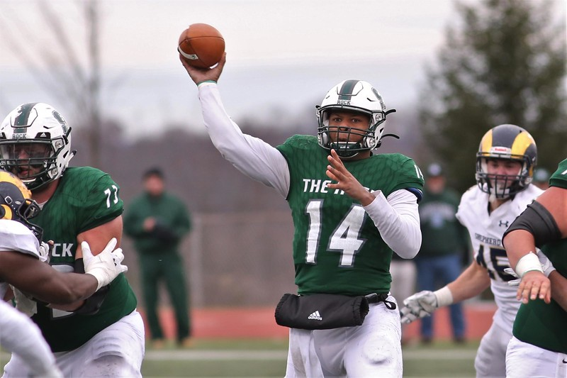 Slippery Rock quarterback Roland Rivers III looks for an open reciever in Saturday's home playoff game against Shepherd University. Rivers threw for 416 yards and four touchdowns in SRU's 51-30 win. Seb Foltz/Butler Eagle