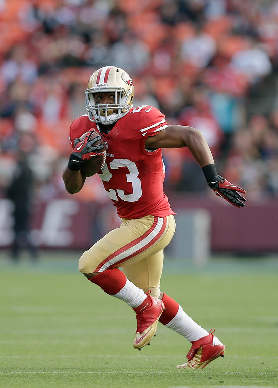 . LaMichael James #23 of the San Francisco 49ers runs with the ball during their preseason NFL game against the Denver Broncos at Candlestick Park on August 8, 2013 in San Francisco, California.  (Photo by Ezra Shaw/Getty Images)