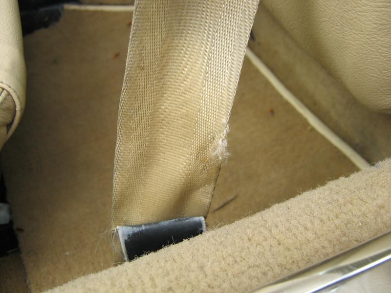 Seat belt frayed - possible safety hazard