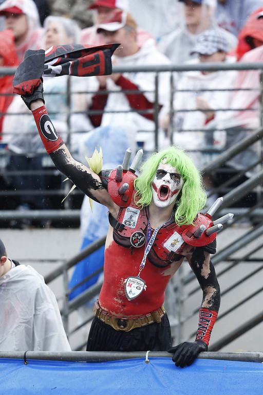 . A Georgia Bulldogs fan cheers in the first half against the Nebraska Cornhuskers during the TaxSlayer.com Gator Bowl at Everbank Field on January 1, 2014 in Jacksonville, Florida. (Photo by Joe Robbins/Getty Images)