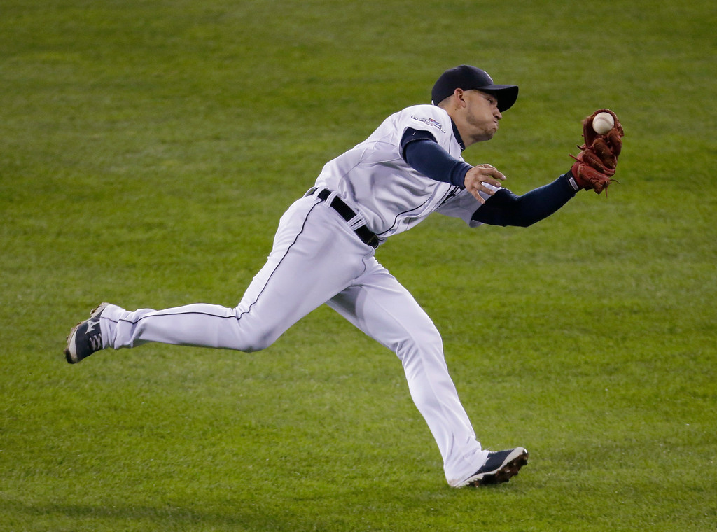 . Detroit Tigers\' Jose Iglesias catches a pop fly by Boston Red Sox\'s David Ortiz in the third inning during Game 5 of the American League baseball championship series Thursday, Oct. 17, 2013, in Detroit. (AP Photo/Charlie Riedel)