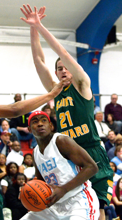 . Jeff Forman/JForman@News-Herald.com Deandre Forte looks to shoot as Will Meyer, St. Edward, defends during the second quarter of the Vikings\' 82-76 loss Feb. 20 at Villa Angela-St. Joseph High School.