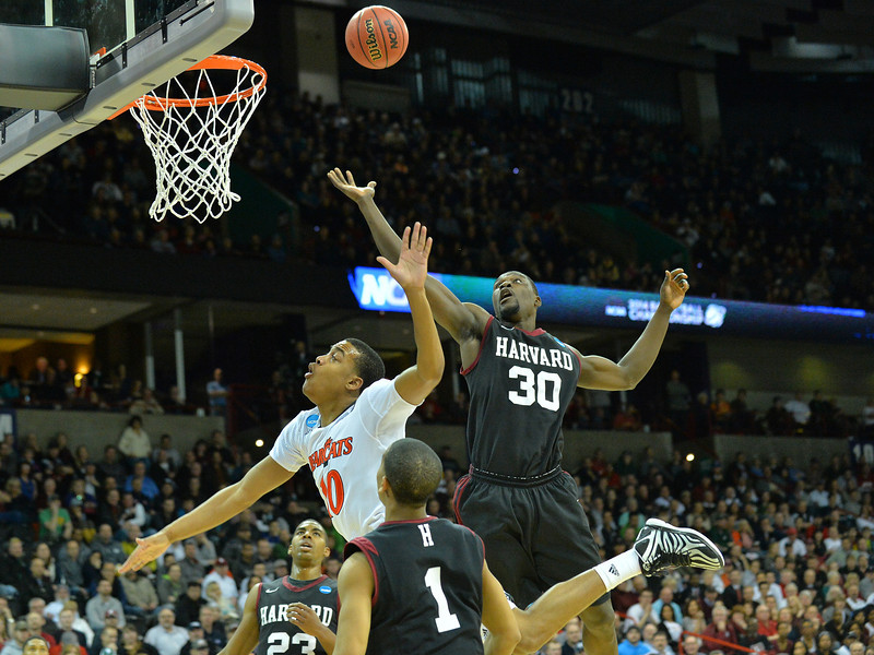 March 20, 2014: Cincinnati Bearcats guard Troy Caupain (10) puts up a wild shot during a second round game of the NCAA Division I Men's Basketball Championship between the 5-seed Cincinnati Bearcats and the 12-seed Harvard Crimson at Spokane Arena in Spokane, Wash. Harvard defeated Cincinnati 61-57.