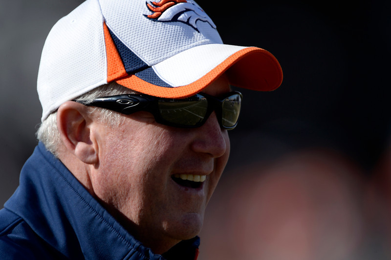 . Denver Broncos head coach John Fox talks tot he media on the field during practice January 9, 2014 at Dove Valley (Photo by John Leyba/The Denver Post)