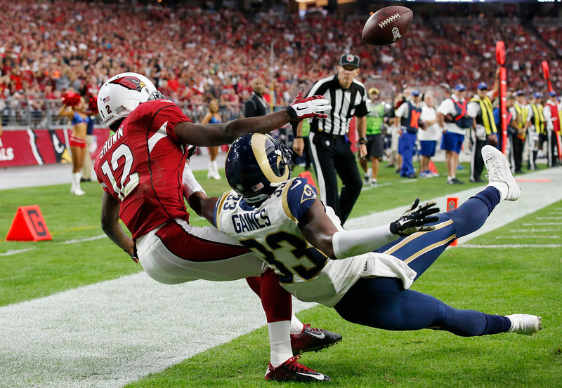 . St. Louis Rams\' E.J. Gaines (33) breaks up a pass intended for Arizona Cardinals\' John Brown (12) during the first half of an NFL football game Sunday, Nov. 9, 2014, in Glendale, Ariz. (AP Photo/Ross D. Franklin)