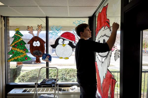 Drury High School art students paint windows-120214