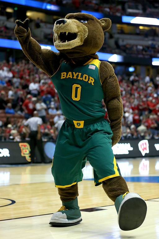 . The Baylor Bears mascot performs during a break in the game against the Wisconsin Badgers during the regional semifinal of the 2014 NCAA Men\'s Basketball Tournament at the Honda Center on March 27, 2014 in Anaheim, California.  (Photo by Jeff Gross/Getty Images)