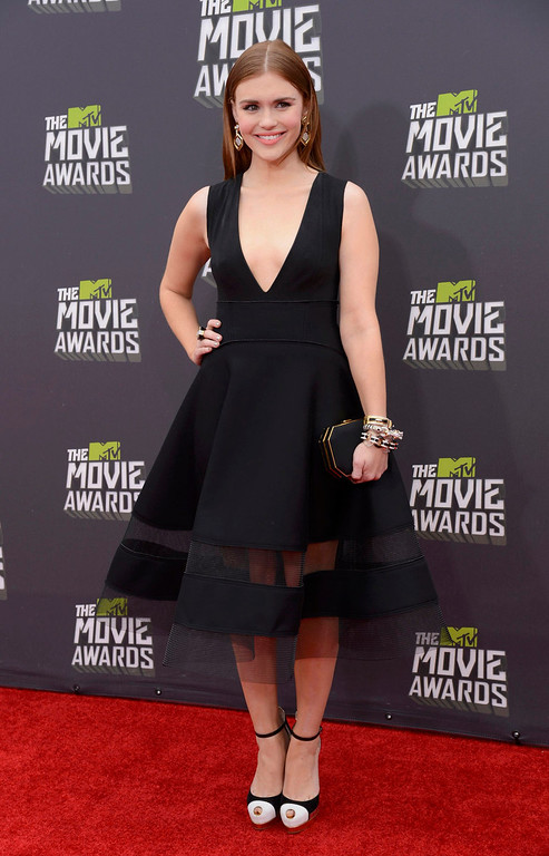 . Actress Holland Roden arrives at the MTV Movie Awards in Culver City, California, April 14, 2013.   REUTERS/Phil McCarten