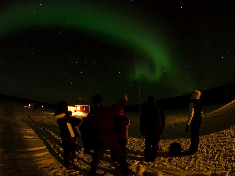 Clear skies again at base camp. Aurora or Northern Lights came out early at 6pm as a weak glow. It slowly strengthened as the night progressed culminating in a dazzling Valentine day display. A group shot with aurora overhead. Again got everyone to stand still for a minute. Not easy in -30C!! Olympus E3, 7-14mm