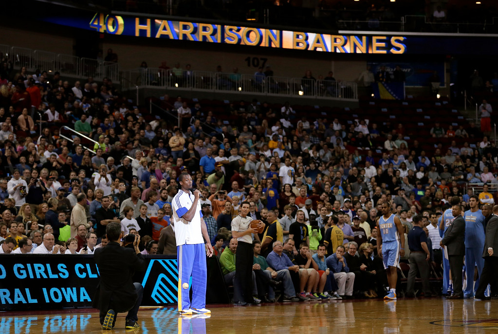 . Golden State Warriors forward Harrison Barnes addresses the crowd before the Warriors\' preseason NBA basketball game against the Denver Nuggets, Thursday, Oct. 16, 2014, in Des Moines, Iowa. Barnes attended high school in nearby Ames, Iowa. (AP Photo/Charlie Neibergall)