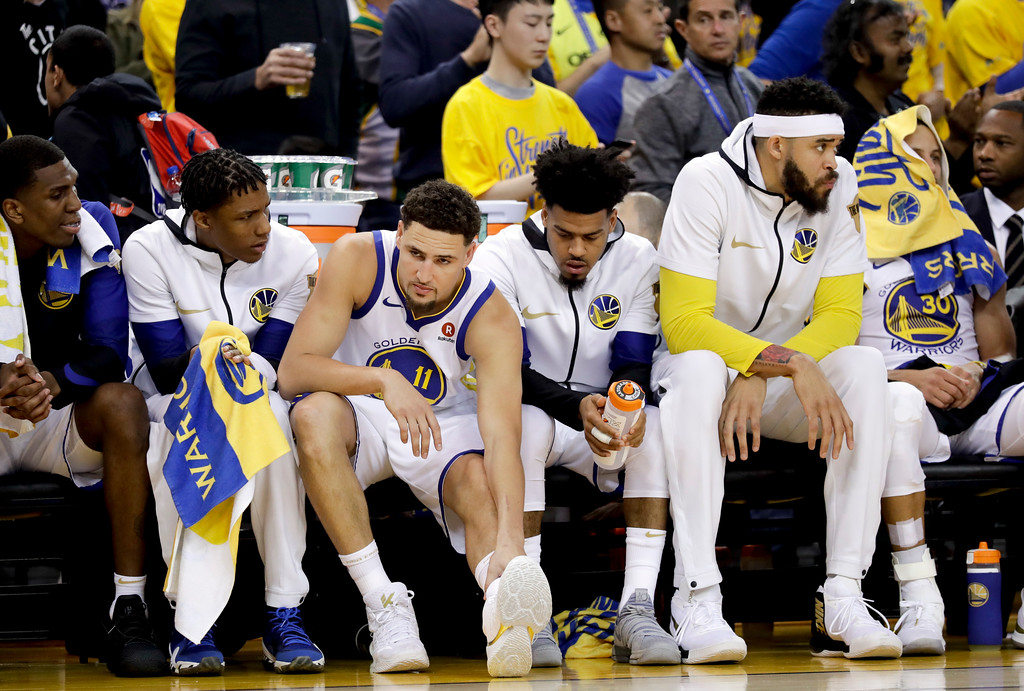 . Golden State Warriors guard Klay Thompson (11) sits on the bench with teammates during the first half of Game 1 of basketball\'s NBA Finals against the Cleveland Cavaliers in Oakland, Calif., Thursday, May 31, 2018. (AP Photo/Marcio Jose Sanchez)