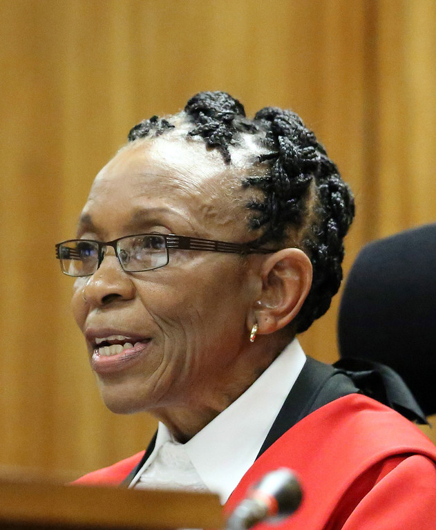 . Judge Thokozile Masipa reads her judgement during sentencing of paralympian  Oscar Pistorius at the high court in Pretoria, on October 21, 2014.  AFP PHOTO/POOL / THEMBA HADEBE/AFP/Getty Images