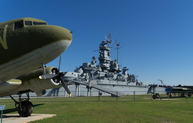 U.S. Army Air Corps C-47 frames the USS Alabama.