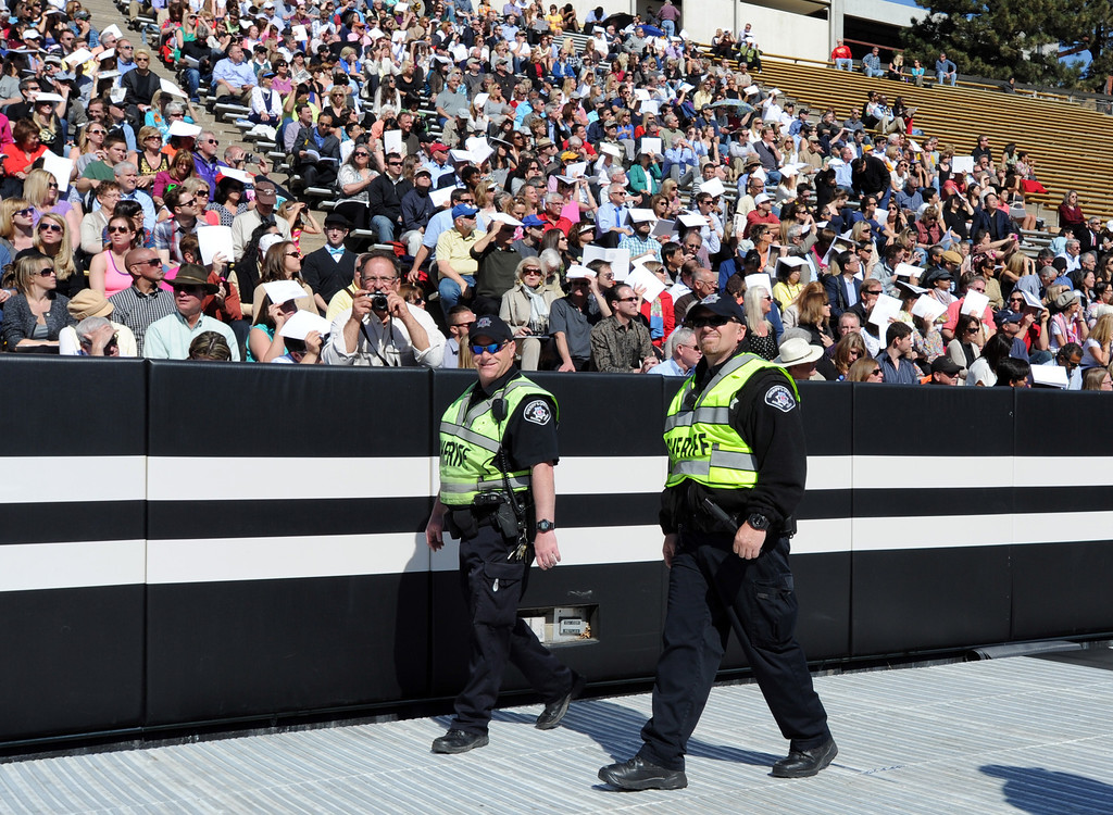 . Boulder County Sheriff\'s deputies patrol Folsom Field during the 2013 University of Colorado  Spring Commencement on Friday in Folsom Field. (Cliff Grassmick/Daily Camera)