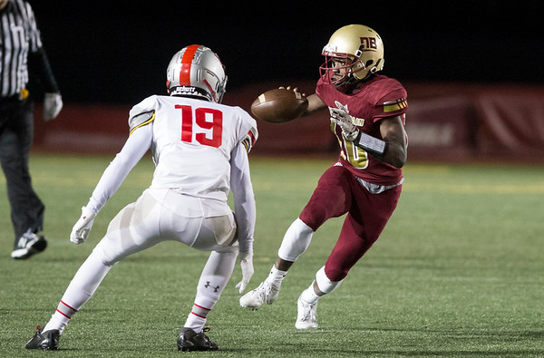 11/01/19 Wesley Bunnell | StaffrrNew Britain football was defeated 17-14 by Conard in OT in a game played on Friday night at Veterans Stadium. QB Tarik Hetmyer (10) looks to lateral the ball to the running back.