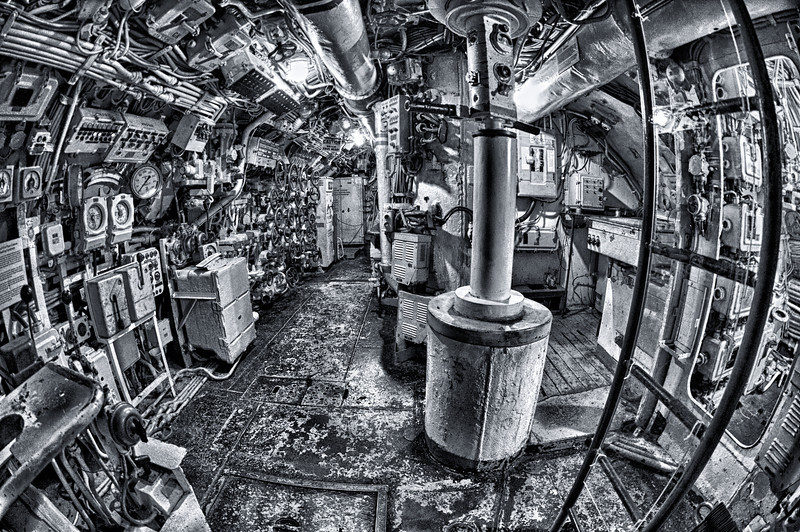 This is a picture of the electronics room that housed the Periscope of an old Soviet Submarine.  I was amazed at how many pumps, nobs and buttons they had in this very confined space.  This was taken with a wide angle lens so it looks large but it is actually very tight and small.