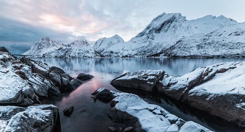 Snowy sunset reflection