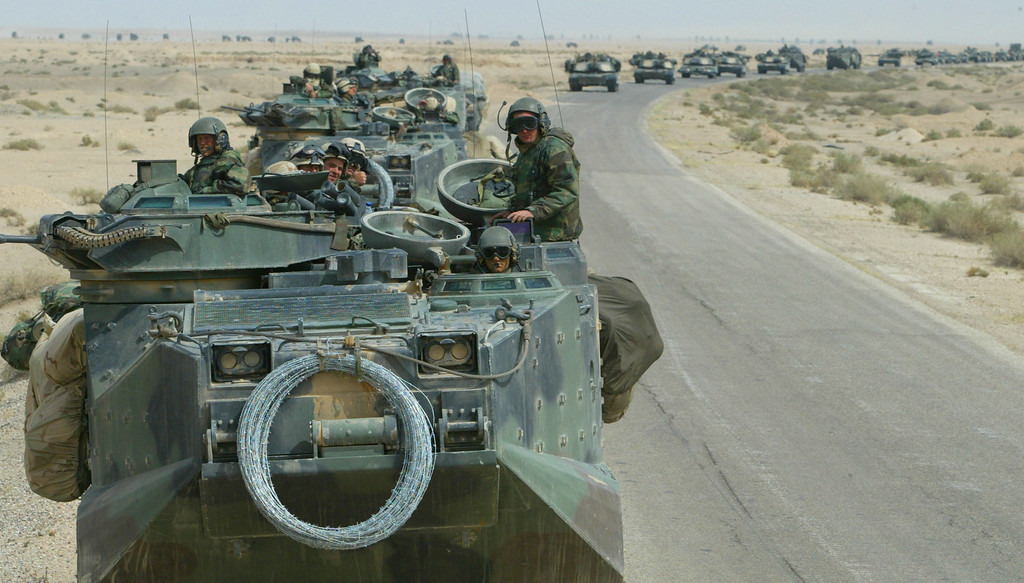 . U.S. Marines from Task Force Tarawa roll through the Iraqi countryside in their armored assault vehicles March 22, 2003 on their way to an objective in Iraq. U.S. and British forces continued to fight in Iraq as they tried to topple the regime of Iraqi President Saddam Hussein. (Photo by Joe Raedle/Getty Images)