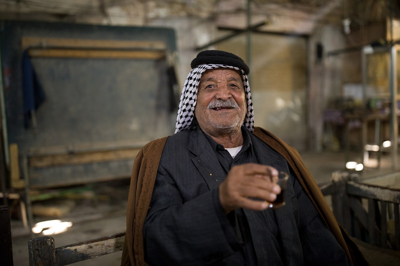 An Iraqi man enjoying tea at the Ottoman-era Al Kifl souq.