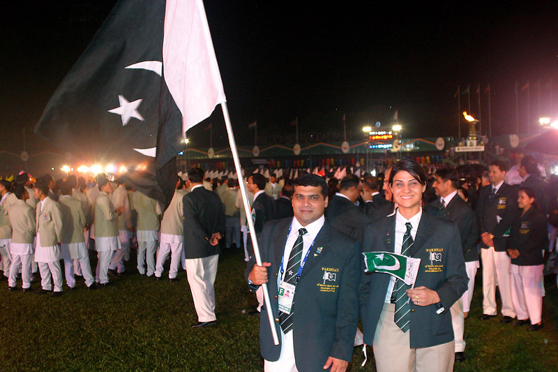 The badminton manager wanted her picture taken with the flag bearer.
