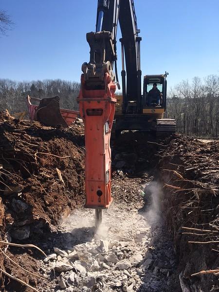 NPK GH15 hydraulic hammer on Deere 350D excavator - trenching - Lykins Contracting 2017 (2).JPG