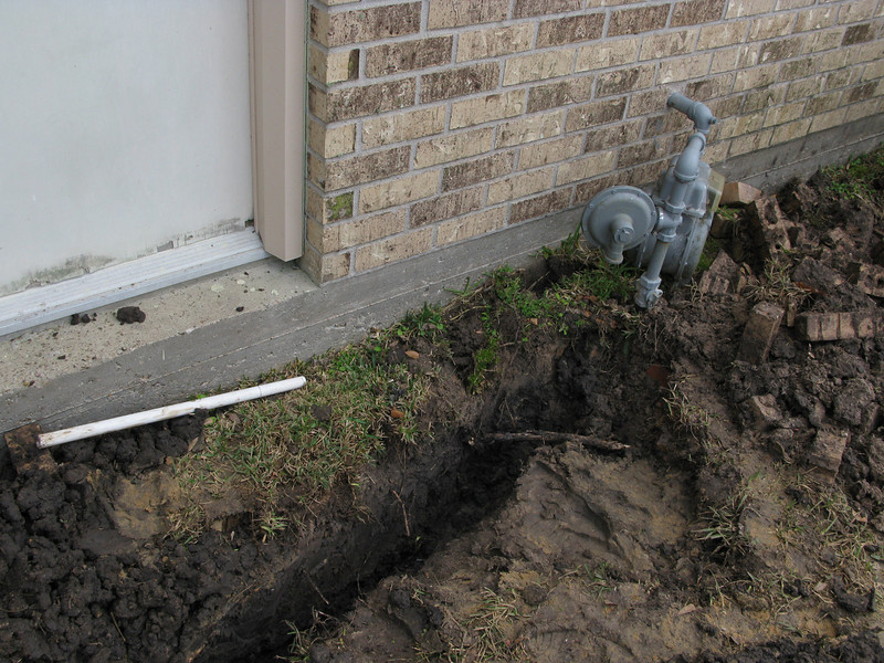 Trenching for the gas line that will feed the furnace and standby generator.