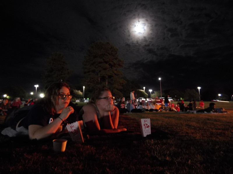 Friday Oct. 6th Freshmen Alexis Starnes and Arieana Alt enjoy popcorn while watching Spiderman: Homecoming at the Bonfire and Movie being held at the practice lacrouse field at 10:00pm.