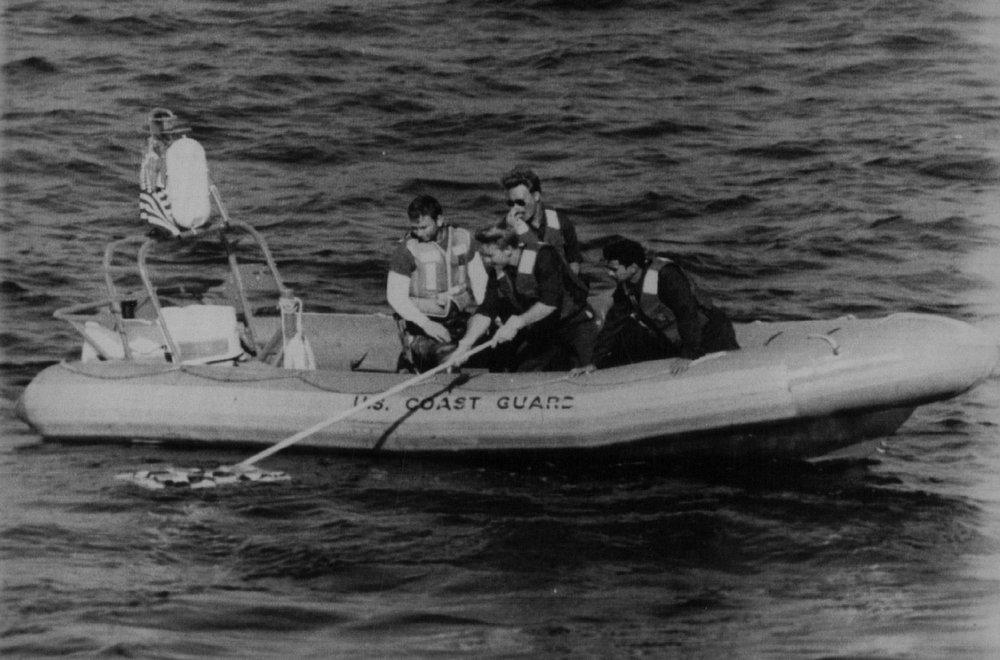 Description of . Coast guardsmen retrieve debris from the Space Shuttle Challenger off the coast of Florida. Denver Post Library Archive