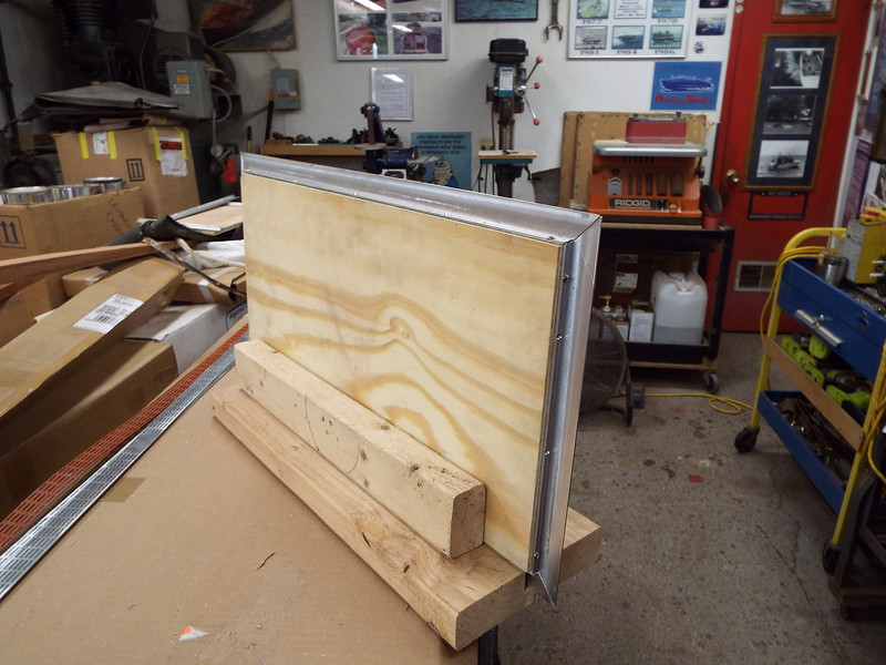 Back side of the floor hatch in the jig with the new trim fit.