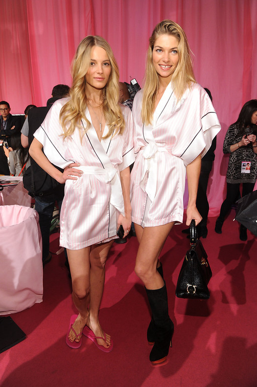 . Models Ieva Laguna and Jessica Hart pose at the 2013 Victoria\'s Secret Fashion Show hair and makeup room at Lexington Avenue Armory on November 13, 2013 in New York City.  (Photo by Jamie McCarthy/Getty Images)