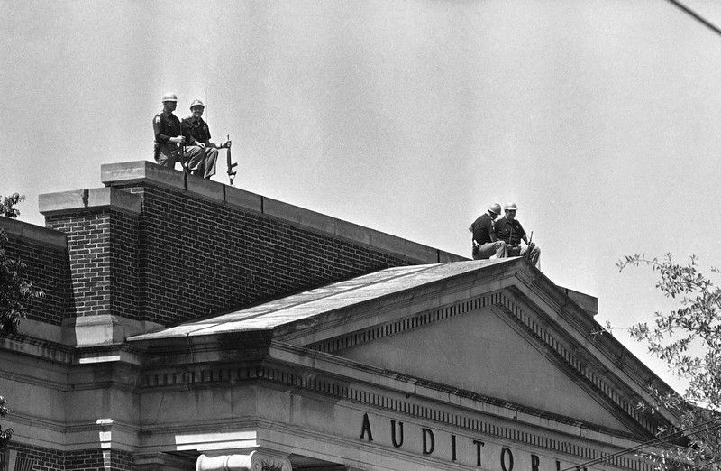 . Heavily armed state Highway Patrolmen stand guard a top Foster Auditorium on the campus of the University of Alabama at Tuscaloosa, Ala., June 11, 1963 as Gov. George Wallace barred an attempt to enroll two black students. (AP Photo)