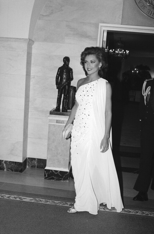 . Vanessa Williams, the newly-crowned Miss America, arrives at the White House in Washington for a state dinner in honor of the visiting West German President Karl Carstens, Oct. 4, 1983. (AP Photo/Ira Schwarz)