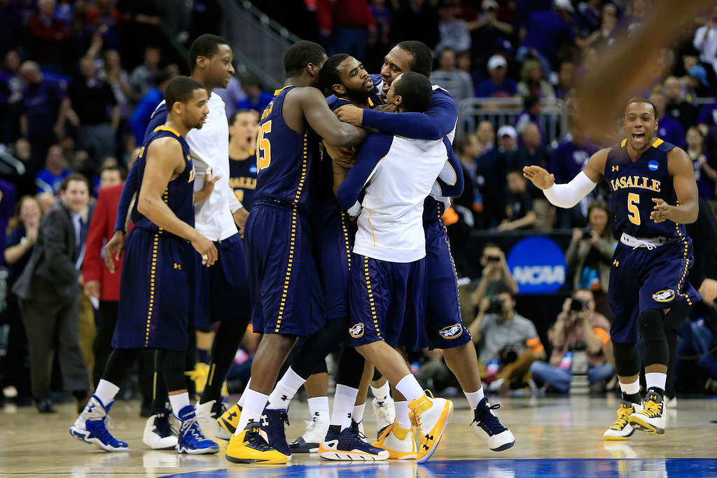 . KANSAS CITY, MO - MARCH 22:  The La Salle Explorers celebrate their 63-61 win over the Kansas State Wildcats during the second round of the 2013 NCAA Men\'s Basketball Tournament at the Sprint Center on March 22, 2013 in Kansas City, Missouri.  (Photo by Jamie Squire/Getty Images)