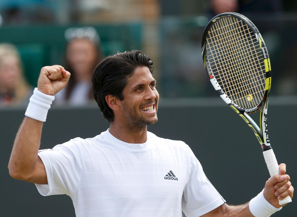 . Fernando Verdasco of Spain celebrates after defeating Kenny De Schepper of France in their men\'s singles tennis match at the Wimbledon Tennis Championships, in London July 1, 2013.             REUTERS/Eddie Keogh