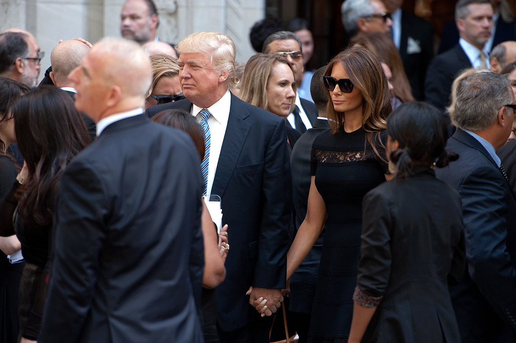 . Donald Trump (center L) and wife Melania Trump attend the Joan Rivers memorial service at Temple Emanu-El on September 7, 2014 in New York City. Rivers passed away on September 4, 2014 after suffering respiratory and cardiac arrest during vocal cord surgery on August 28, 2014.  (Photo by D Dipasupil/Getty Images)
