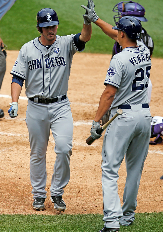. San Diego Padres\' Jake Goebbert is congratulated by teammate Will Venable (25) after scoring a solo home run off Colorado Rockies\' Jair Jurrjens during the fourth inning of a baseball game on Wednesday, July 9, 2014, in Denver. (AP Photo/Jack Dempsey)
