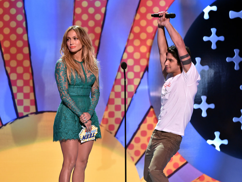 . Recording artist Jennifer Lopez (L) and actor Tyler Posey onstage during FOX\'s 2014 Teen Choice Awards at The Shrine Auditorium on August 10, 2014 in Los Angeles, California.  (Photo by Kevin Winter/Getty Images)