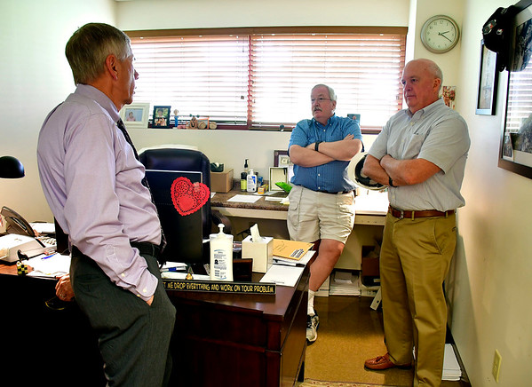 7/30/2019 Mike Orazzi Plymouth Mayor Dave Merchant talks with Nutmeg Spice Company's Greg Miller and David Barrett on Tuesday afternoon.