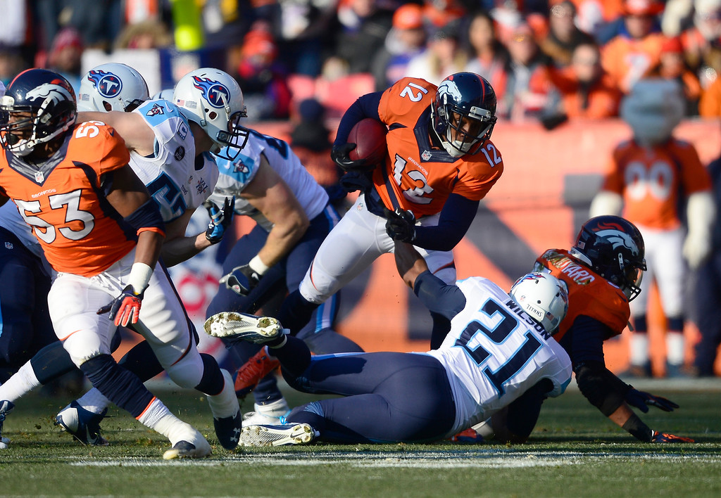. Denver Broncos wide receiver Andre Caldwell (12) returns a punt in the first quarter.  (Photo by AAron Ontiveroz/The Denver Post)