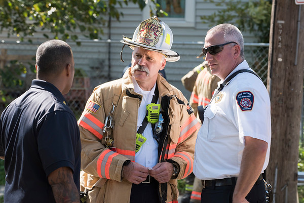 09/25/19 Wesley Bunnell | StaffrrA fire on the first floor of 24 Oak St was quickly knocked down by firefighters on Wednesday afternoon. Fire Chief Raul Ortiz, L, Deputy Chief Paul Walsh & Deputy Chief Michael Berry.