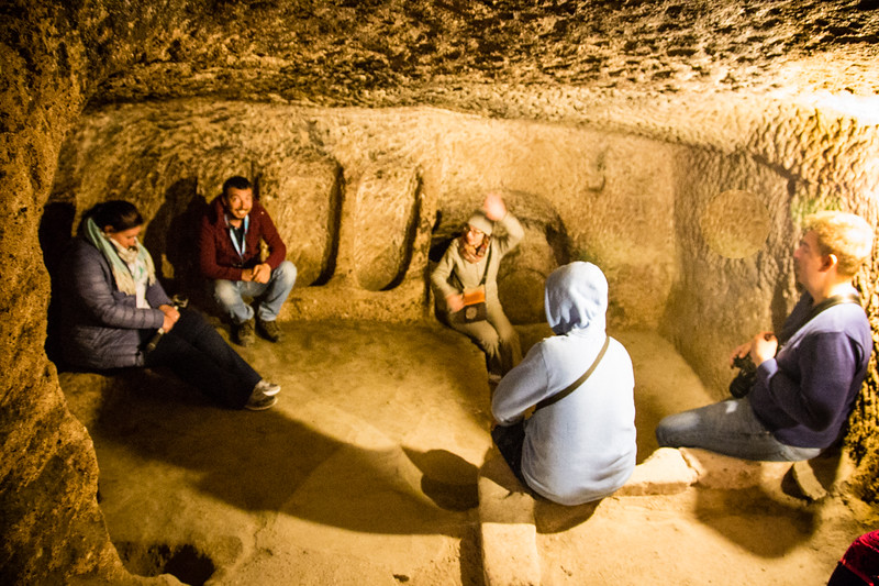 People sitting inside a cave