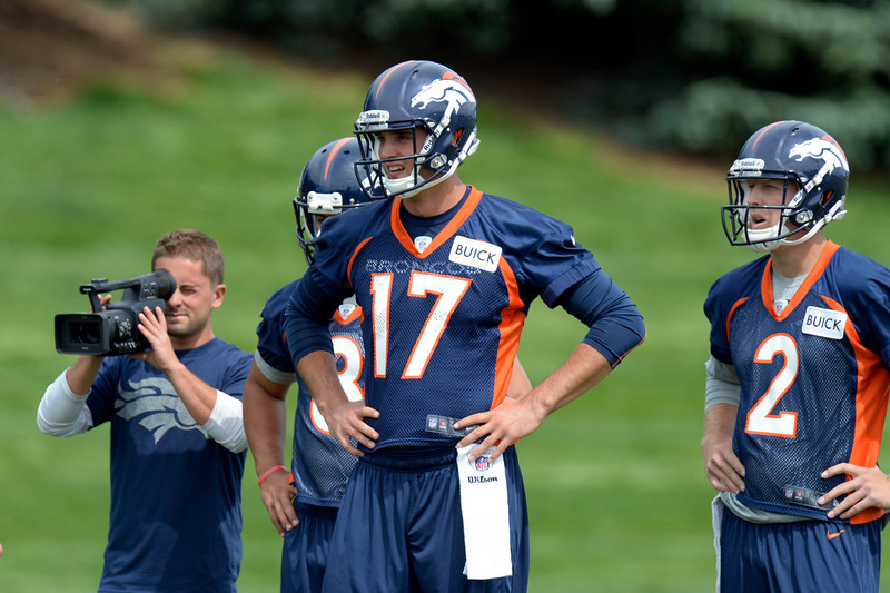 . Brock Osweiler (17) quarterback of the Denver Broncos and Zack Dysert (2) watch drills during mini camp June 12, 2013 at Dove Valley. (Photo By John Leyba/The Denver Post)