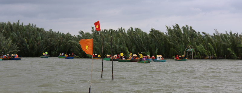 Hundreds of tourists from Asian are in Bamboo Bowl boats.