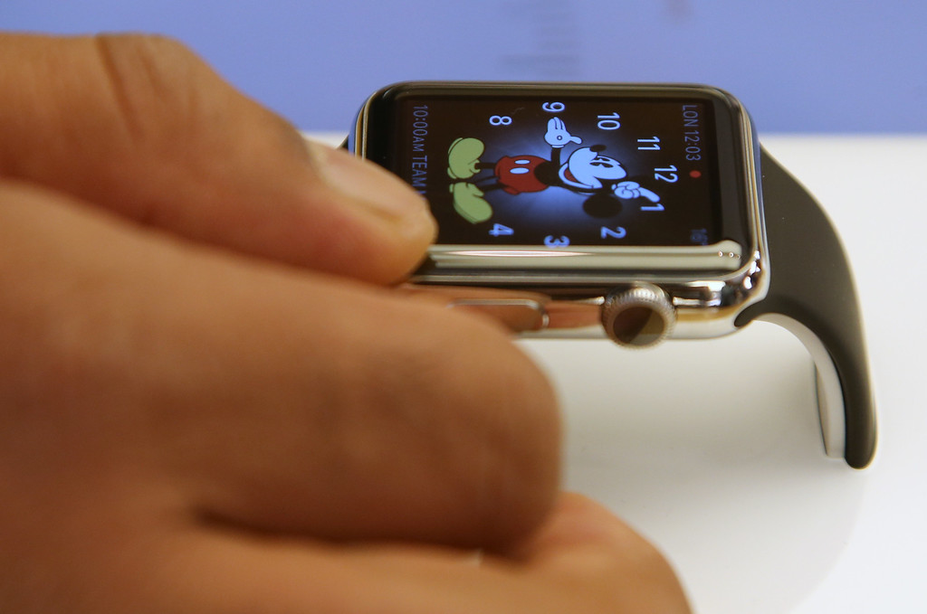 . A customer handles an Apple Watch as the public have its first chance to see, touch and pre-order the watch in Sydney, Friday, April 10, 2015. Prices start at $349, but can go as high as $17,000 for a luxury edition in gold. (AP Photo/Rick Rycroft)