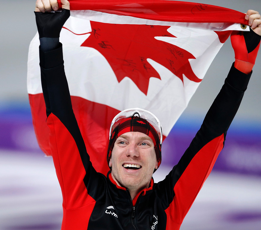 . Gold medallist Ted-Jan Bloemen of Canada celebrates with the national flag after the men\'s 10,000 meters speedskating race at the Gangneung Oval at the 2018 Winter Olympics in Gangneung, South Korea, Thursday, Feb. 15, 2018. (AP Photo/Vadim Ghirda)