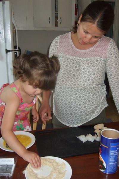 Guen helps Hanna cook.