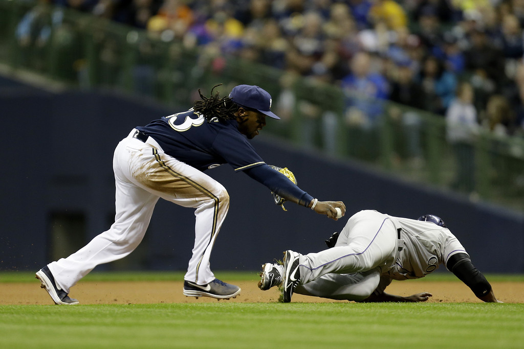 . MILWAUKEE, WI - APRIL 2: Rickie Weeks #23 of the Milwaukee Brewers runs down Chris Nelson #4 of the Colorado Rockies between first and second base in the top of the second inning at Miller Park on April 2, 2013 in Milwaukee, Wisconsin. (Photo by Mike McGinnis/Getty Images)