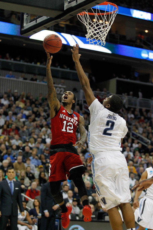 . Anthony Barber #12 of the North Carolina State Wolfpack puts up a shot in front of Kris Jenkins #2 of the Villanova Wildcats in the first half during the third round of the 2015 NCAA Men\'s Basketball Tournament at Consol Energy Center on March 21, 2015 in Pittsburgh, Pennsylvania.  (Photo by Justin Aller/Getty Images)