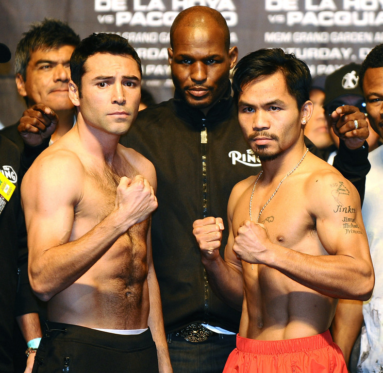 . Oscar De La Hoya(L) fasces off  Manny Pacquiao during the weigh in Las Vegas. The two will fight each other Saturday night at the MGM Grand Hotel December 6th on HBO-PPV in Las Vegas NV. Dec 5,2008. Photo by Gene Blevins/LA Daily News